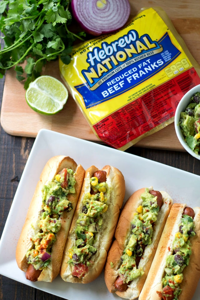 Southwestern Guacamole Hot Dogs- grilled Hebrew National Hot Dogs topped with flavorful Southwestern Guacamole. This one's a major crowd-pleaser!