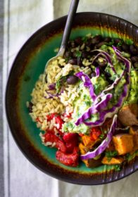 Looking for a quick, nutritious, flavorful meal? This Easy Vegan Buddha Bowl is ridiculously healthy, a cinch to whip up and tasty as can be!