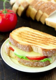 Celebrate National Grilled Cheese Day in the most delicious way possible- with an irresistible Caprese Grilled Cheese with Pesto!