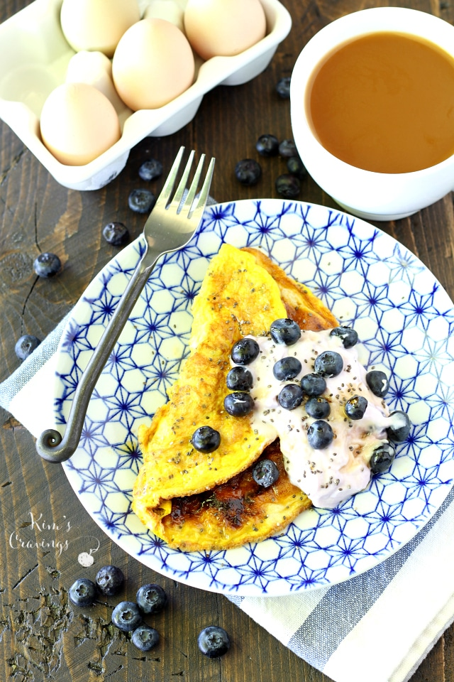 A light, maple flavored sweet omelet topped Greek yogurt and juicy blueberries is the perfect change of pace for breakfast!