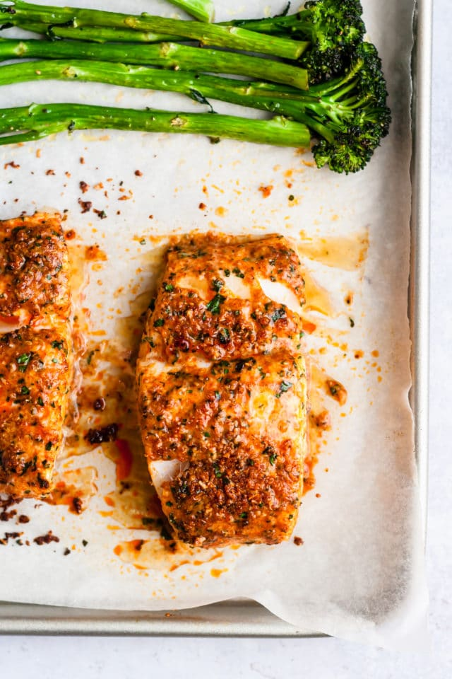 baked fillet of cod on a baking tray lined with parchment paper