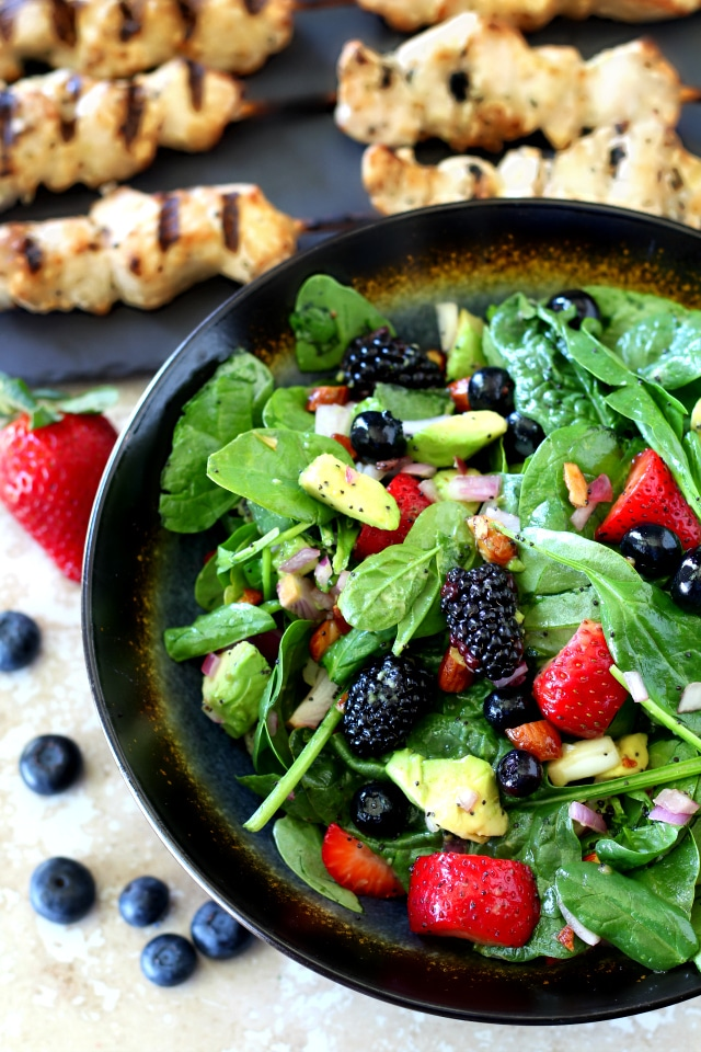 Get ready to shake up your summer cookout with this sweet, colorful and oh-so-sassy easy-to-make bright triple berry almond spinach salad! (vegan, dairy and gluten free)