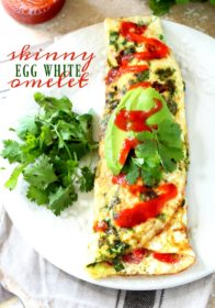 Uber healthy, totally delicious and probably the easiest thing you'll ever make in your kitchen, this Skinny Egg White Omelet with spinach and tomato is where it's at if you're looking to get lean.