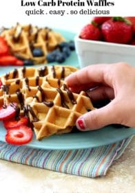 hand taking a piece of waffle
