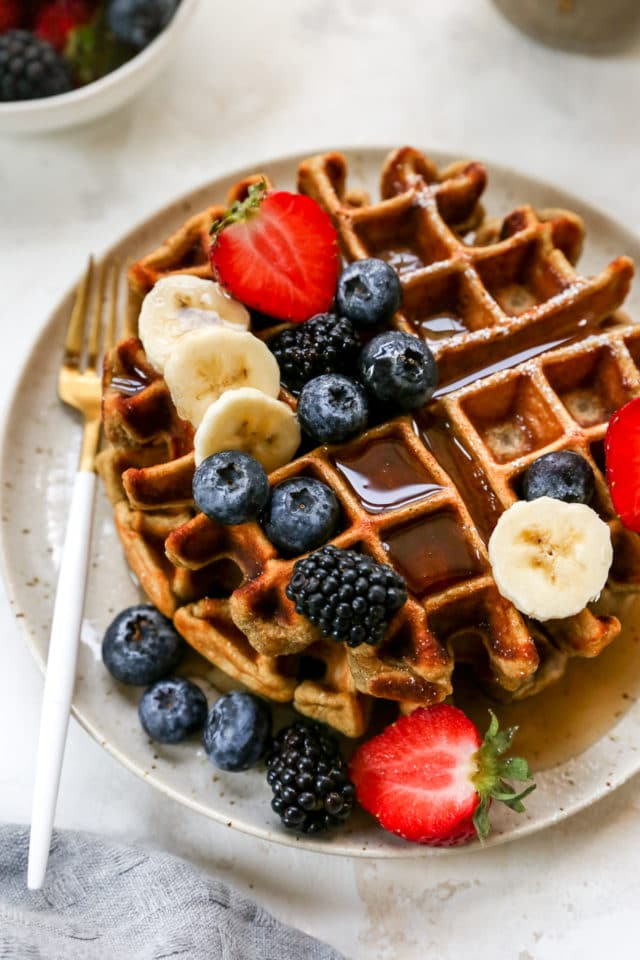 protein waffles served with fruit and maple syrup