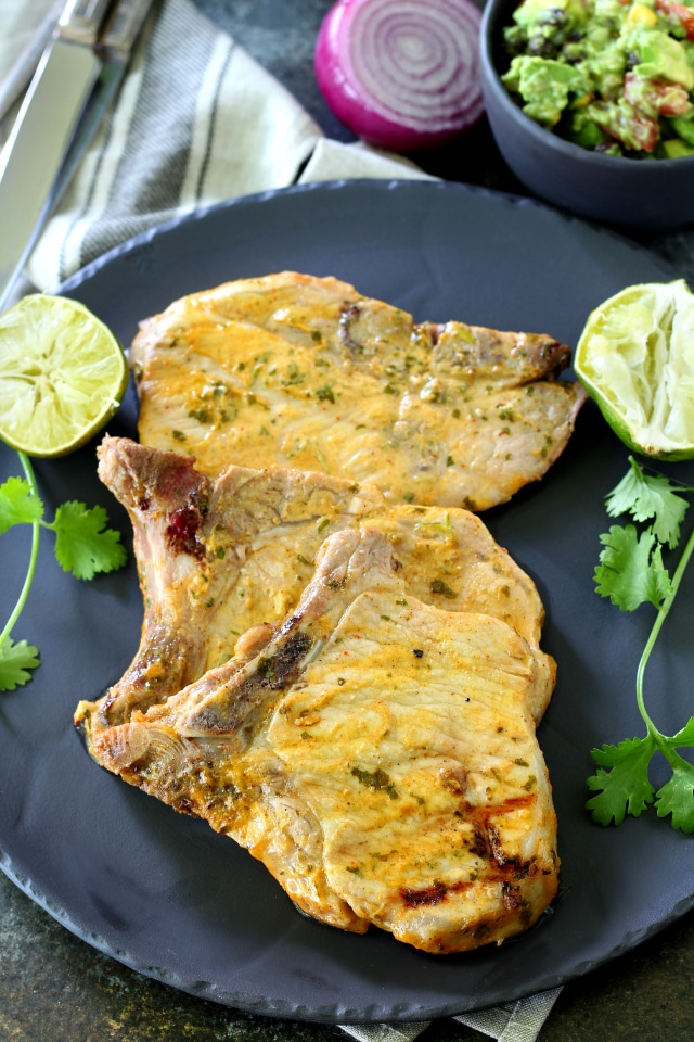 This recipe for Cilantro Lime Grilled Pork Chops With Southwestern Guacamole is beyond flavorful and so EASY to make too! The pork chops cook up in less than 10 minutes on the grill and come out super juicy and incredibly tasty.