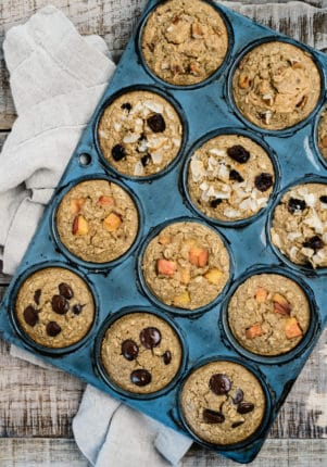 oatmeal muffins with different toppings in a muffin pan