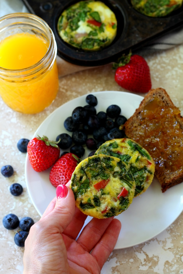 Spinach Ham Egg Muffins with lean ham, spinach and bell pepper are so flavorful, uber healthy, gluten free, dairy free and paleo. They're the perfect on-the-go breakfast and even kid-friendly!