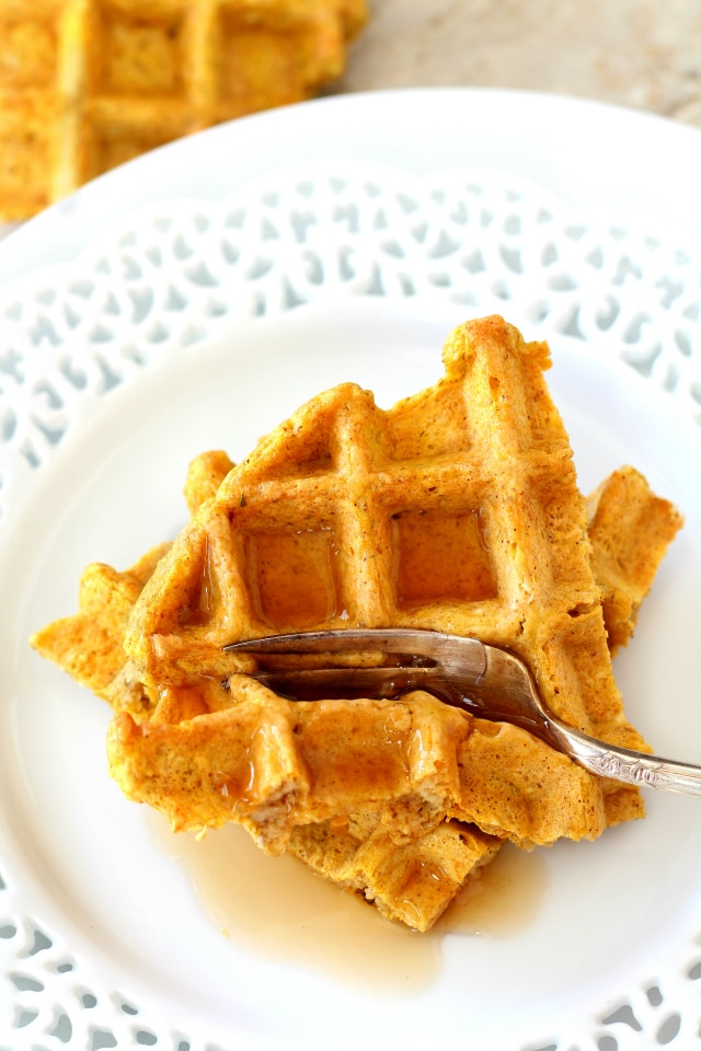 Gluten-Free Pumpkin Oat Waffles - loaded with delightful fall flavor without any of the guilt. Whip them up in the blender to get your morning started easily and deliciously!