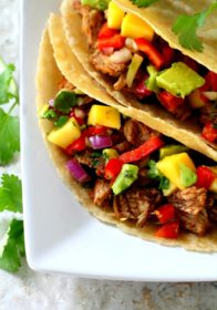 Slow Cooker Carnitas with Mango Avocado Salsa- a simple, tasty recipe for making tender, juicy, perfectly cooked carnitas in your slow cooker!