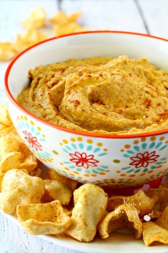 Traditional hummus gets a major kick of flavor with everyone's favorite fall fruit in this healthy pumpkin hummus.