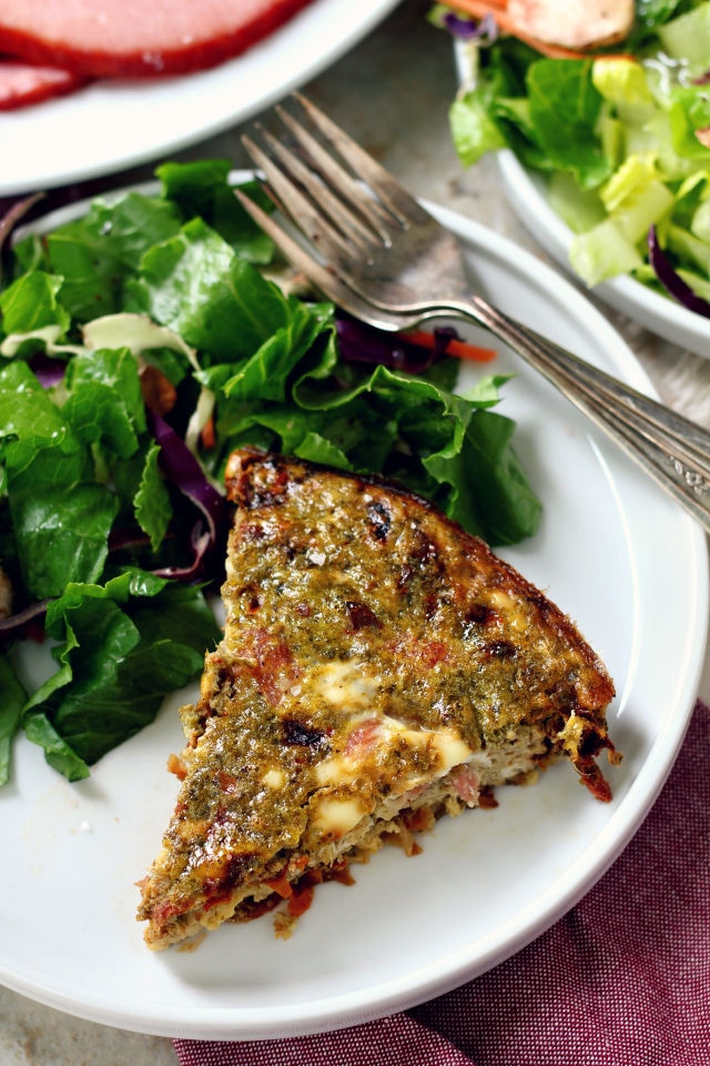 This Sun-Dried Tomato Pesto Ham Frittata is salty, savory, packed with flavor and the perfect addition to your holiday brunch spread.