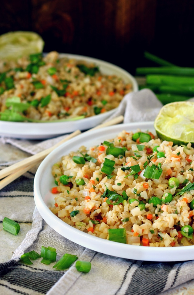 This Easy Cauliflower Fried Rice recipe is super healthy, full of veggie goodness and packed with protein. It comes together in less than 20 minutes and is completely customizable. Go vegetarian or add chicken, fish, shrimp, you name it!