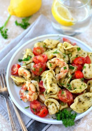 Wholesome and delicious Easy Pesto Shrimp Tortellini Salad made simply with basil pesto, tasty tortellini, roasted tomatoes and quick-cooking shrimp. Just 4 main ingredients in only 20 minutes - the perfect quick + easy dinner!