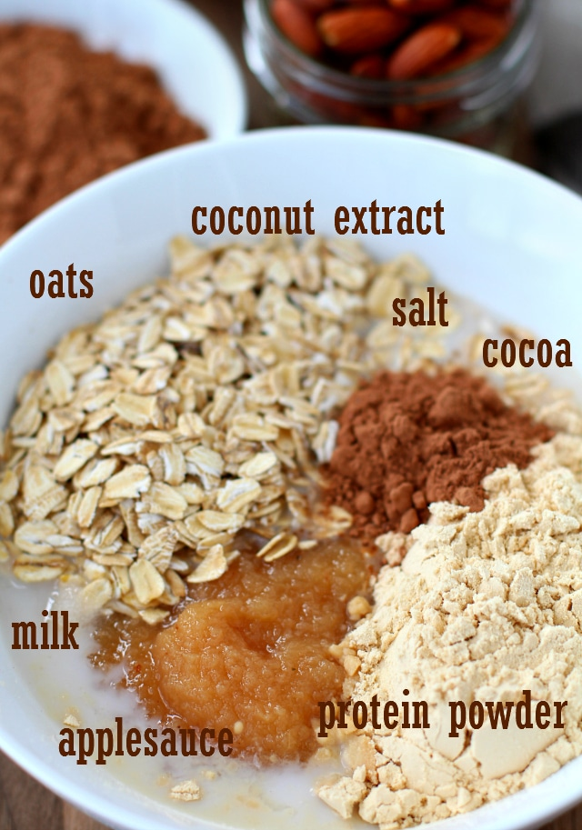 ingredients for Almond Joy Protein Overnight Oatmeal in a white bowl