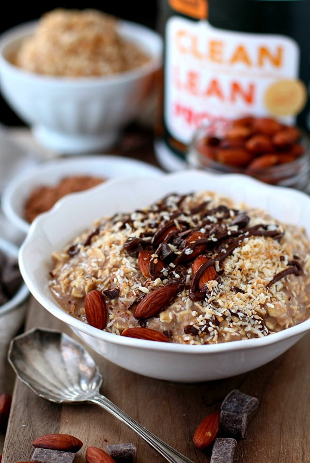 Almond Joy Protein Overnight Oatmeal served in a white bowl with a silver spoon