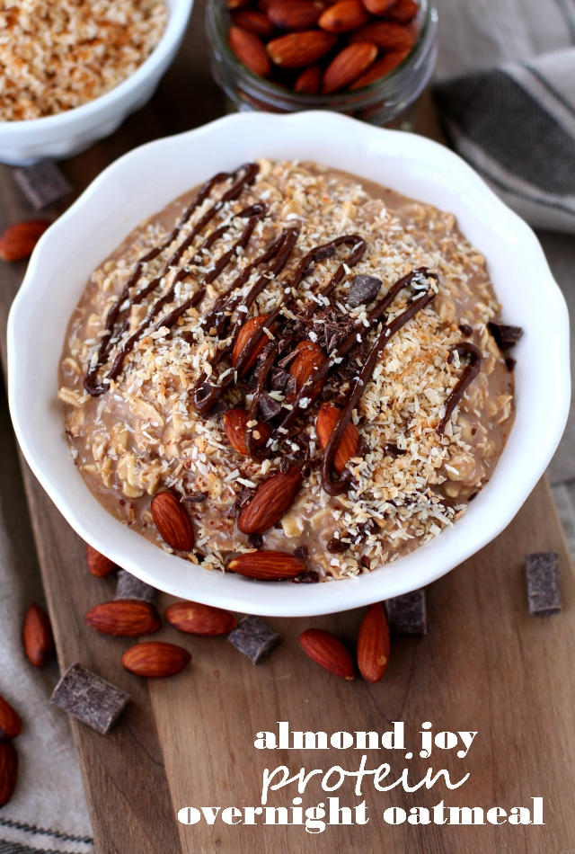 Almond Joy Protein Overnight Oatmeal in a white bowl served with almonds and chocolate
