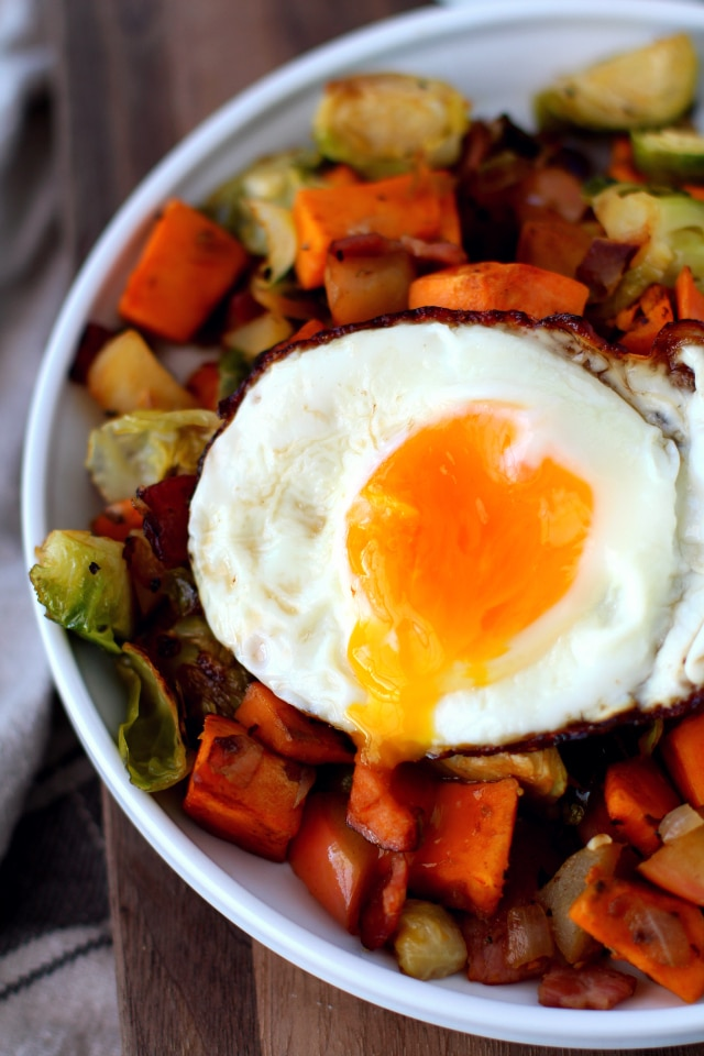 Breakfast Hash with Sweet Potato, Brussels Sprouts, Apple and topped with a Fried Egg is the perfect addition to your brunch, but also works so well as breakfast for dinner!