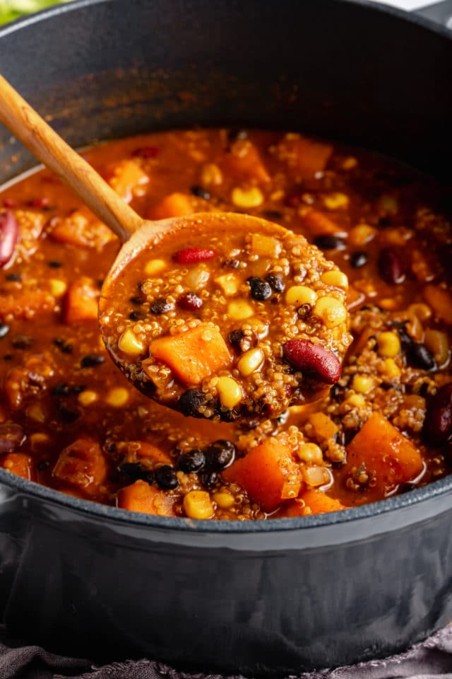 serving vegetarian chili with a ladle