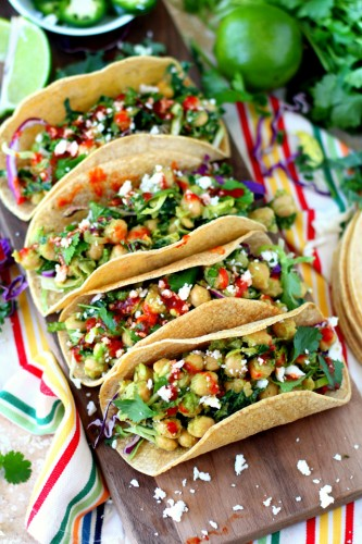Insanely delicious Chickpea Avocado Tacos. Hearty, healthy, and ready in less than 20 minutes with no heat required. The perfect plant-based, gluten-free lunch or dinner!