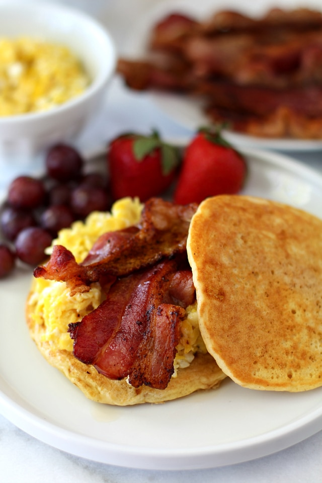 Rise and shine, lovelies, we're cooking up the ultimate of breakfast sandwiches! You guys are going to go crazy for these Bacon Egg Pancake Breakfast Sandwiches!