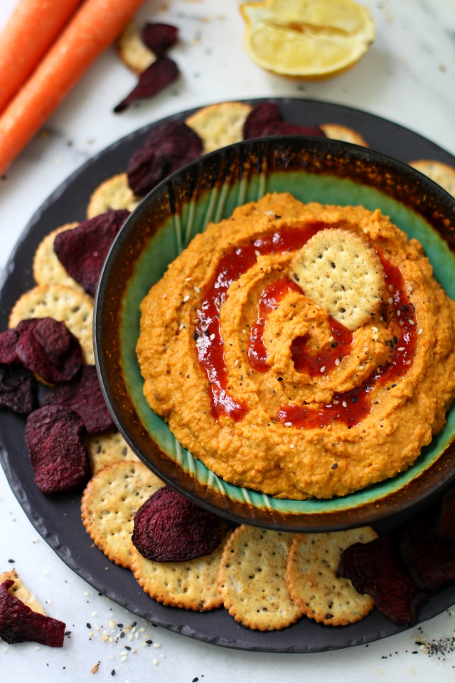 The perfect marriage of sweet and spicy - this Zesty Carrot Ginger Hummus is the perfect appetizer to ring in spring time snackin'!