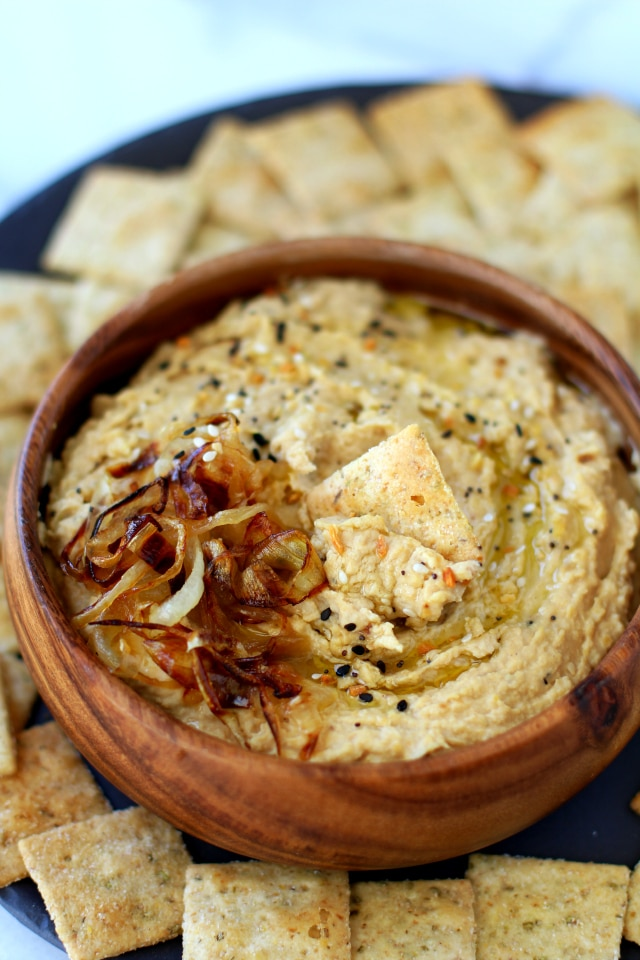 You may never want to buy store bought hummus again. This Flavorful Caramelized Onion Hummus is irresistible!