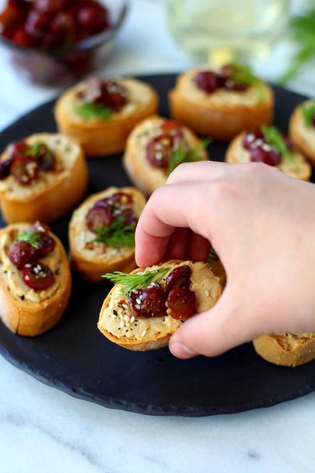 Roasted Grape Caramelized Onion Hummus Crostini - This appetizer is bursting with flavor and is a crowd-pleaser at any event! {vegan & gluten-free}