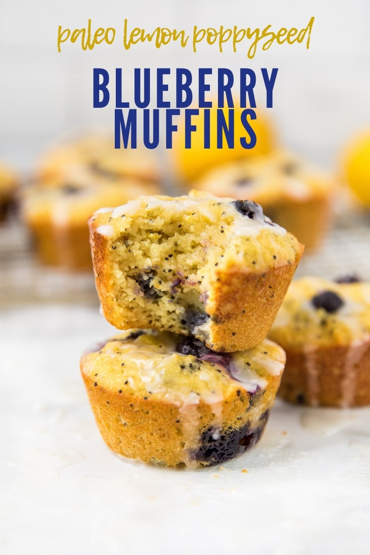 2 blueberry muffins stacked with other muffins in the background
