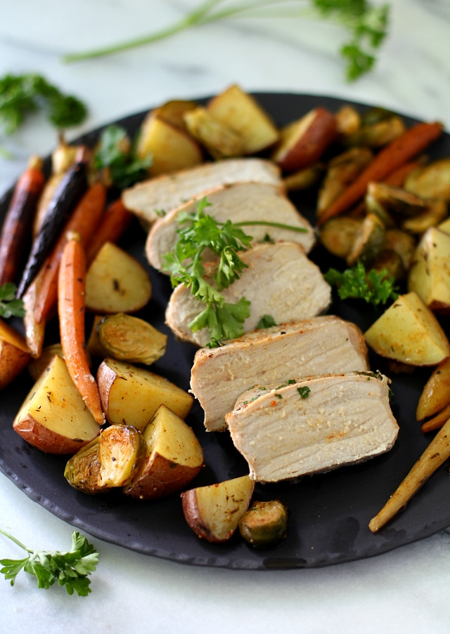 Sheet Pan Pork Meal with red potatoes, carrots and Brussels sprouts - an easy, healthy, one-pan meal perfect for busy weeknights!