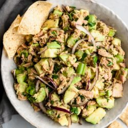 Avocado Tuna Salad served in a large bowl with tortilla chips