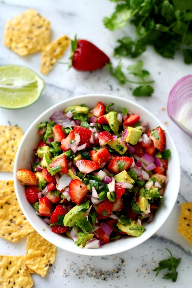 Easy Strawberry Avocado Salsa Recipe makes a delicious fruity appetizer, snack, or even served as a topping for chicken, fish or salads.