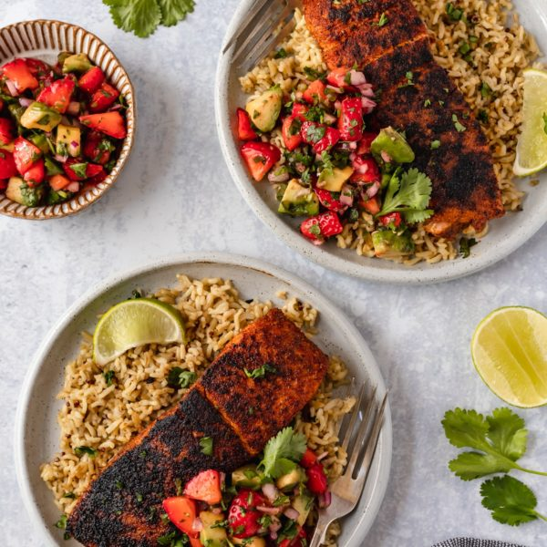 blackened salmon served with strawberry salsa over rice
