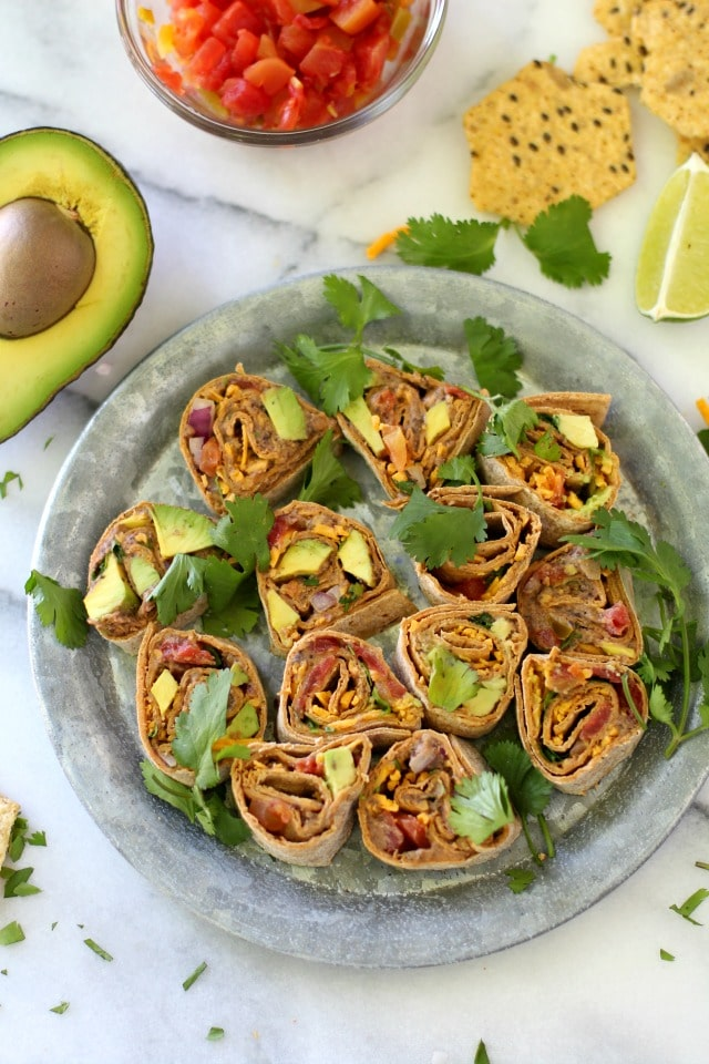 Healthy Southwestern Pinwheels are the perfect appetizer for summertime parties and they even make for a fun lunch or snack idea. These crowd pleasers are super yummy, easy to make and can even be prepared ahead of time.