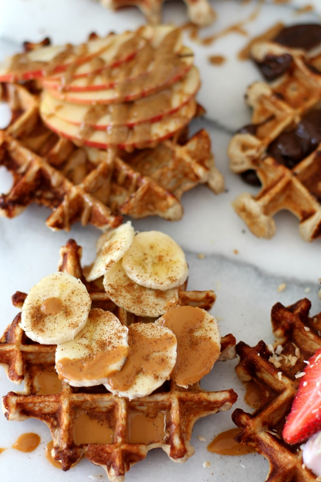 Top these fluffy yogurt protein waffles with your favorites! From banana slices to peanut butter, these waffles are so yummy!