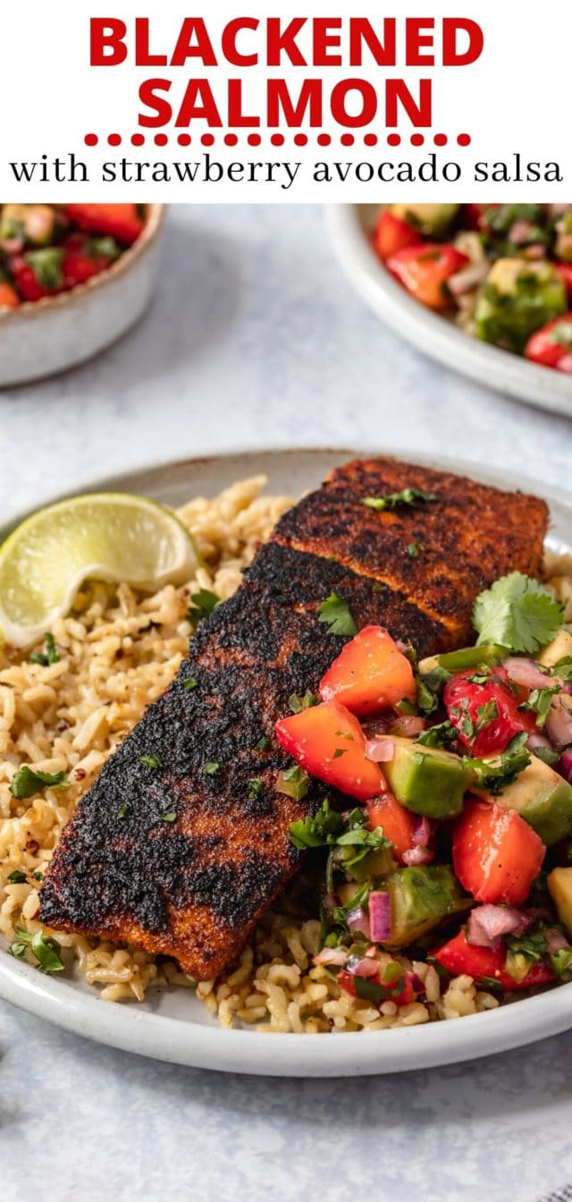 blackened salmon plated with strawberry avocado salsa and rice