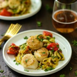 The absolute most perfect date night meal - Seared Scallops with Bacon Zucchini Noodles. It's a little bit of fancy with a huge amount of flavor and so super easy to cook up. You and your sweetheart will go ga-ga over this healthy, cozy meal!