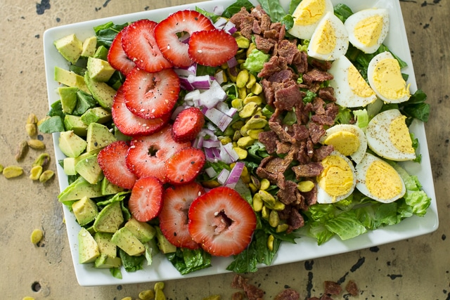 This delicious Whole30 Strawberry Cobb Salad is quick and easy to make, full of great fresh flavors, and tossed with a simple strawberry dressing.