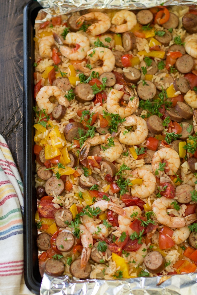 This Wholesome Sheet Pan Jambalaya is a major crowd-pleaser, uses only one pan and is totally mess-free. That's right. ONE PAN. No newspapers. No bags. No clean-up!