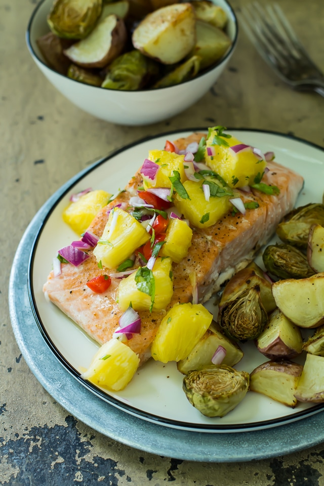 This one pan cajun salmon is super juicy with just kick of spice and gets topped off with a tangy hit of pineapple salsa. All made on one tray and ready in 30 minutes.