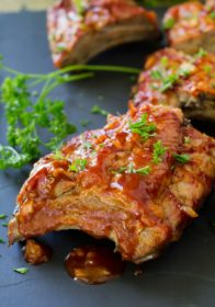 Grilled Sriracha Ribs are fallingoff the bone amazing, cooked on the grill and smothered in an irresistible saucy Sriracha sauce! Who knew you could enjoy amazing ribs, right at home?