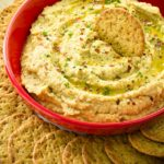 Easy 10 minute Super Flavorful Ranch Hummus is so creamy dreamy irresistibly delicious. And I'm warning you, it's quite addictive!! Not only is this an amazing and easy dip, it works fantastic as a spread for a sandwich or roll-up as well.