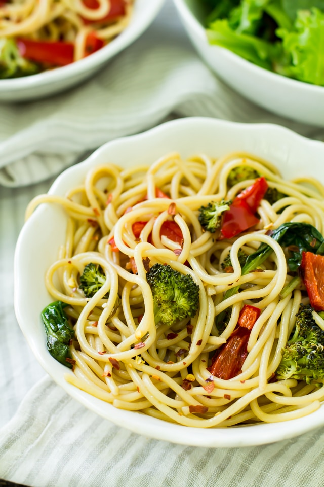 This Roasted Veggie Spinach Pasta features loads of spinach and roasted vegetables tossed with a light balsamic sauce and served over my favorite Skinner® pasta!