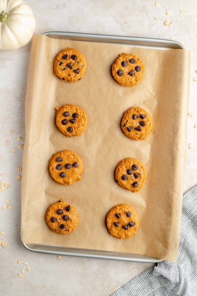healthy pumpkin cookie on a parchment-lined baking sheet