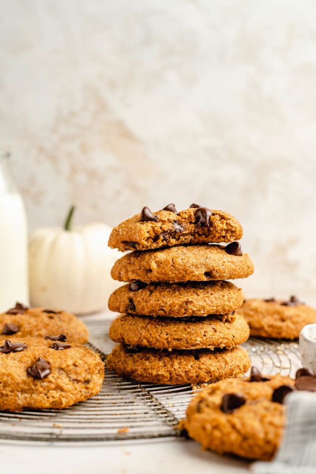 healthy pumpkin cookies stacked on a wire cooling rack