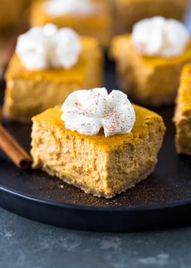 pumpkin cake square with whipped cream topping