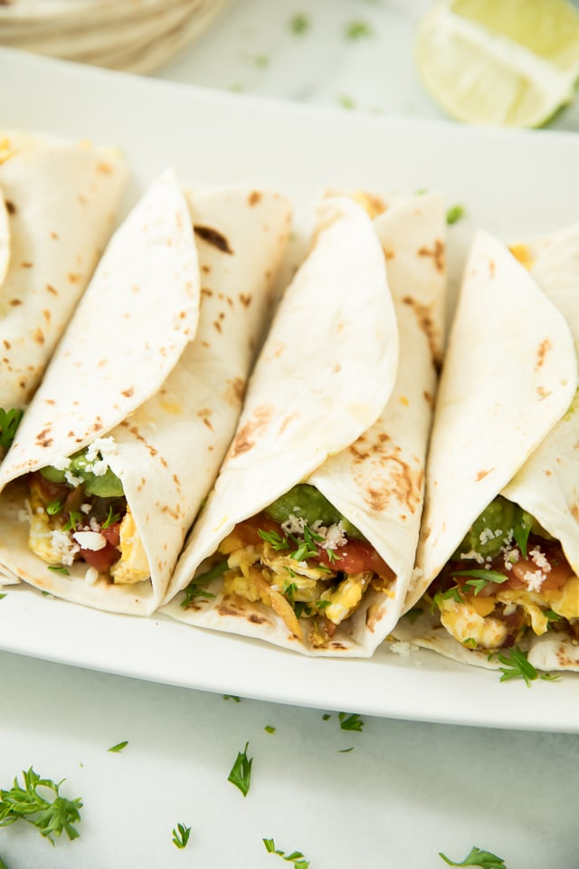 These Mexican Breakfast Tacos are the perfect healthy morning meal for on-the-go. They're so easy, delicious and can be made gluten free and vegetarian to please the whole family!