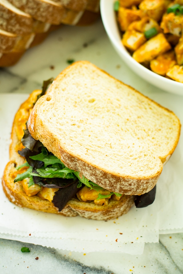 Brimming with savory fall flavors, this Spicy Pumpkin Chicken Salad Sandwich is bound to be a lunch recipe you'll want to enjoy all season long!