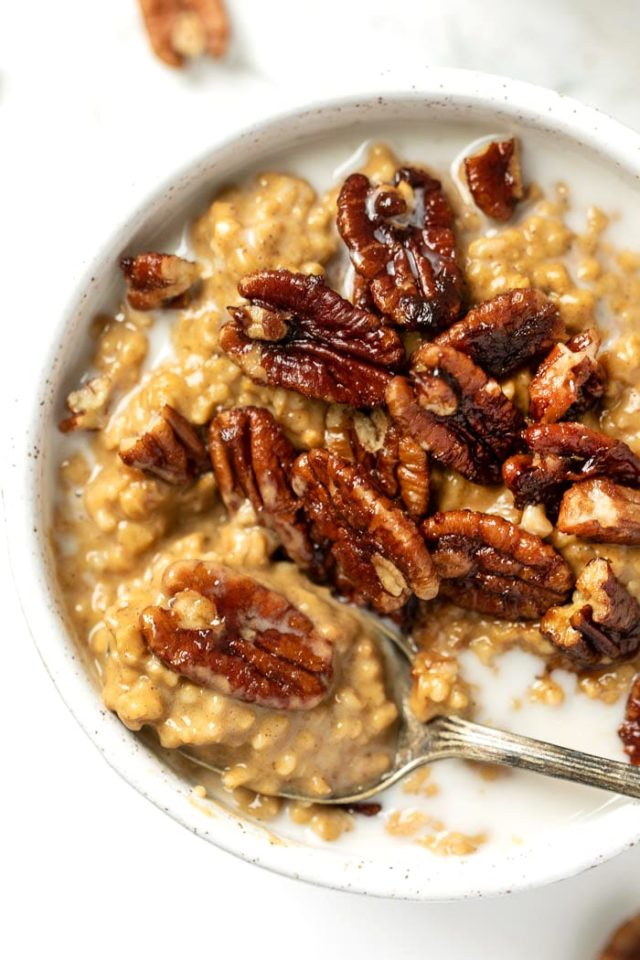 pumpkin steel cut oats topped with pecans and a splash of milk