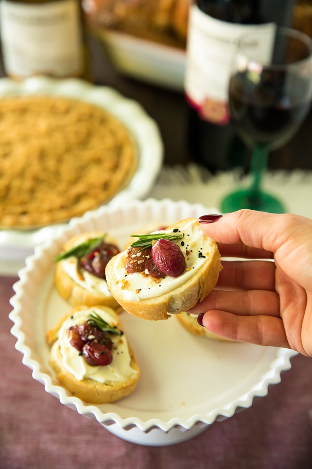 Roasted Grape Crostini is an easy, elegant appetizer that's perfect for the holiday season. Oven-roasted balsamic-infused grapes, complement creamy ricotta and crusty bread so deliciously and it's especially lovely served with wine.